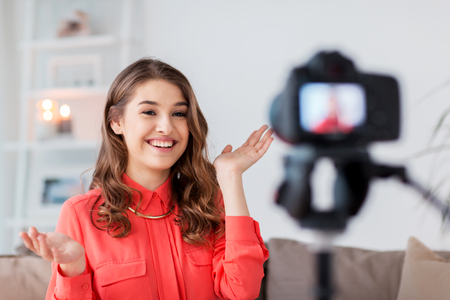 woman with camera recording video at home Stock Photo