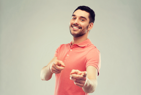 man pointing finger to you over gray background
