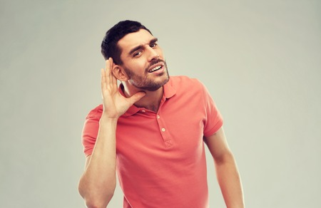 man having hearing problem listening to something Stock fotó