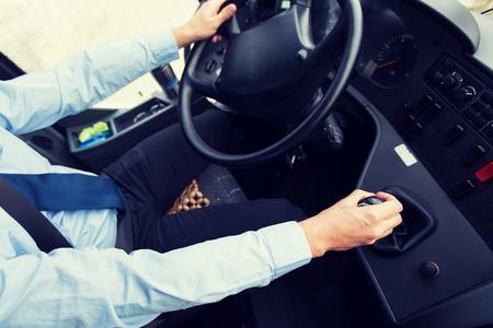 persona viajando: close up of driver driving passenger bus