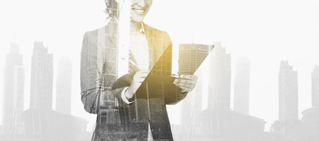 businesswoman with clipboard over city buildings photo
