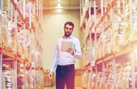 businessman with tablet pc at warehouse Stock Photo