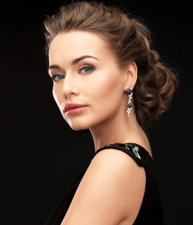 clubs diamonds: beautiful woman in evening dress wearing diamond earrings