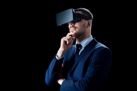 business, people, augmented reality and modern technology concept - businessman in virtual headset over black background Reklamní fotografie