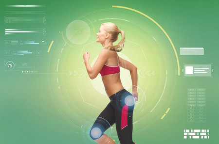 fitness, sport, people and technology concept - smiling young woman running over green background