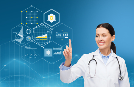 healthcare, medicine, people and technology concept - happy smiling doctor with stethoscope pointing finger to virtual charts over blue background