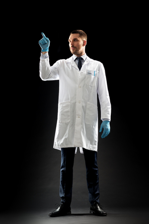 doctor or scientist in lab coat and medical gloves