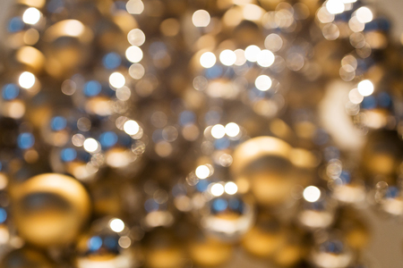 golden christmas decoration or garland of beads Stock Photo