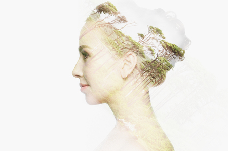young woman face: people, nature and beauty concept - beautiful young woman face with natural double exposure effect over white background