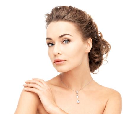 close-up of beautiful woman wearing shiny diamond necklace Stock Photo