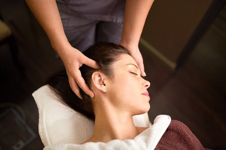woman having head massage at spa