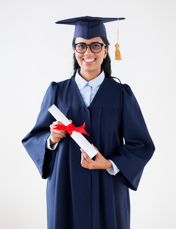 happy bachelor woman in mortarboard with diplomas Stock Photo