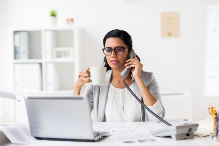 phone professional: businesswoman calling on phone at office
