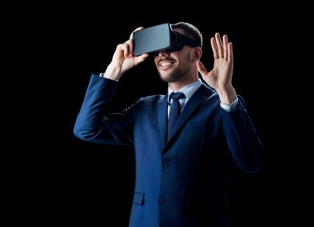mediated: businessman in virtual reality headset over black
