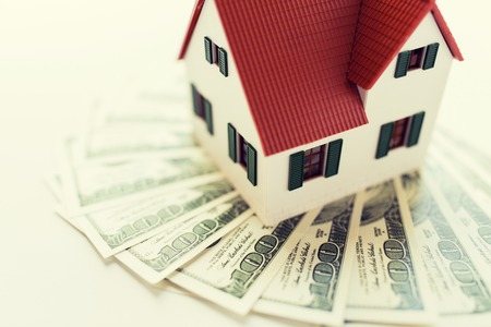 building estate: building, mortgage, investment, real estate and property concept - close up of home or house model and money Stock Photo
