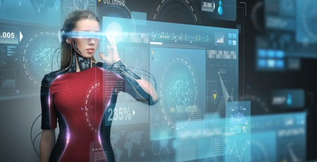 augmented reality, technology, business, future and people concept - woman in virtual glasses and microchip implant or sensors looking at screen projections over dark background Stock Photo