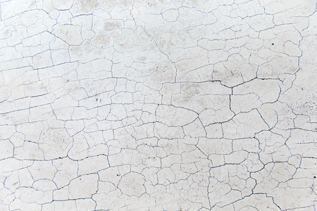 crack: background and texture concept - close up of cracked stone wall or surface