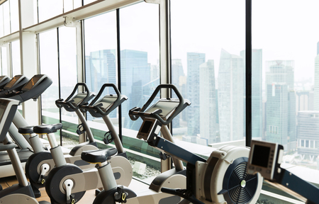 multiple objects: sport, fitness and equipment concept - exercise bikes in gym