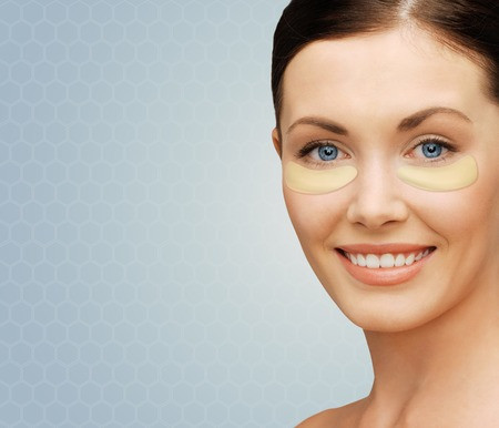 undereye: close up of woman face with under-eye patches Stock Photo