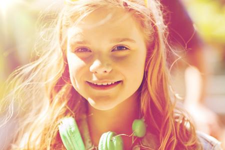 careless: happy teenage girl with headphones