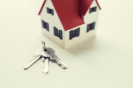 close up of home model and house keys