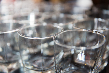 empty old-fashioned glasses at bar