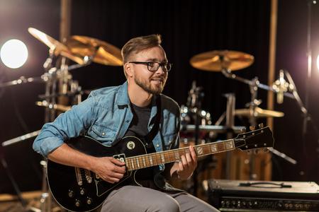 man playing guitar at studio rehearsal photo