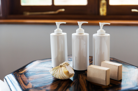 bottles with liquid soap or lotion at spa