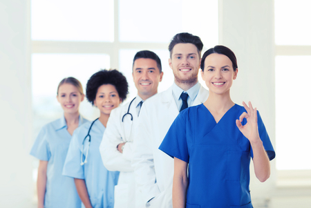 stuff: group of happy doctors at hospital