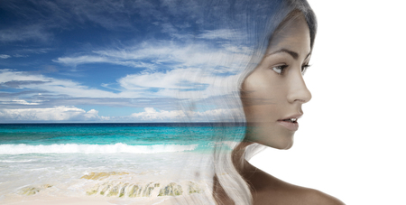 beautiful young woman face over beach background photo