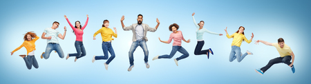 happy people or friends jumping in air over blue