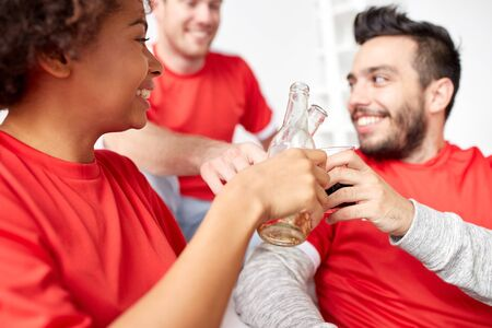 happy friends or football fans with beer at home