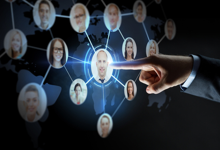 network people: business, people, employment, headhunting and network concept - close up of businessman hand pointing finger to virtual contact projection over black background