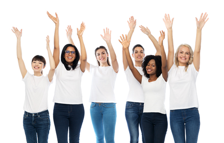 diversity, race, ethnicity and people concept - international group of happy smiling different women in white blank t-shirts having fun Stock Photo