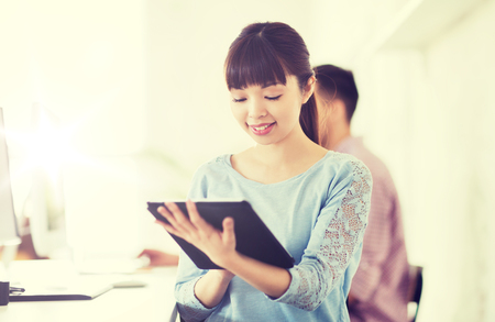 application university: happy creative female office worker with tablet pc