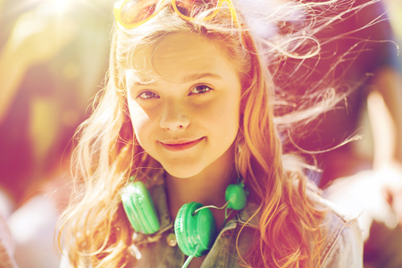 happy teenage girl with headphones