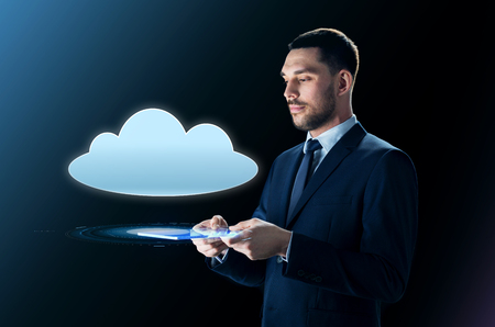businessman with tablet pc and cloud projection Stock Photo