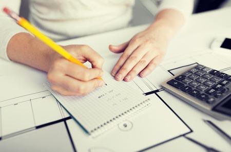 architect: close up of architect hand writing to notebook Stock Photo