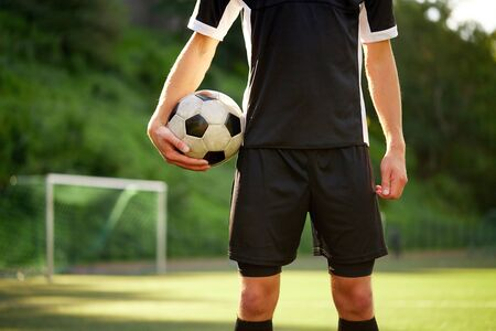 soccer player with ball on football field Stock Photo