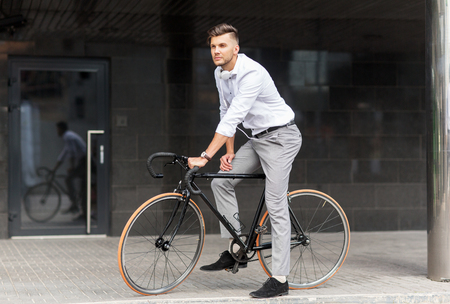 man with bicycle and headphones on city street Stock Photo