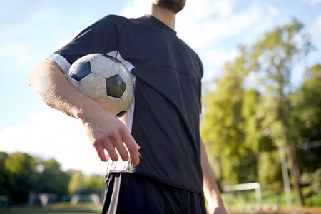 close up of soccer player on football field