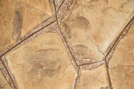背景、デザインと質感のコンセプト - 装飾の石のタイル表面