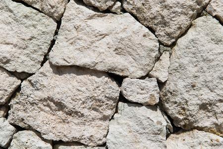 石積み、石積み、背景やテクスチャのコンセプト - 粒子の粗い石の壁