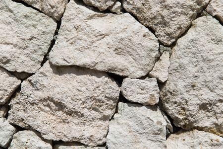 stonework, masonry, background and texture concept - grainy stone wall Stock Photo