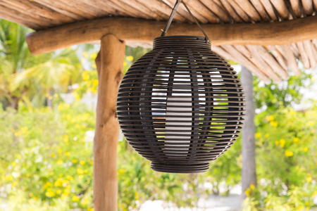 irradiation: lantern hanging under shed roof Stock Photo