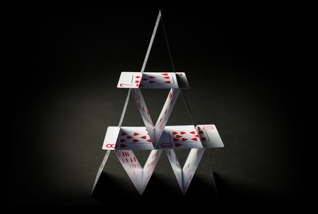 house of playing cards over black background Stock Photo