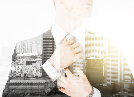 business and people concept - close up of man adjusting his tie over city with double exposure