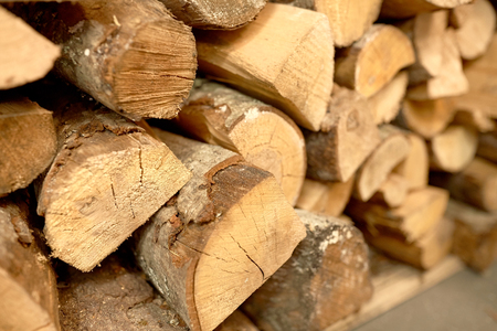 multiple objects: stove heating and wood fuel concept - close up of firewood