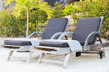 daybed: sunbeds on exotic resort beach Stock Photo
