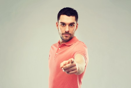 warned: angry man pointing finger to you over gray